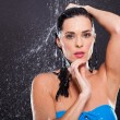 Sensual woman in water splashes — Stock Photo