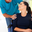 Loving husband talking to handicapped wife - Стоковая фотография