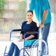 Stock Photo: Caring husband and handicapped wife