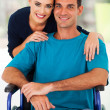 Stock Photo: Loving wife and handicapped husband