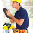 Cctv camera technician recording serial number - Stock Photo