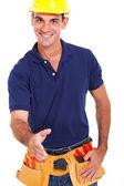 Repairman with handshake gesture — Stock Photo