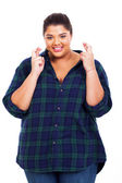 Pretty young overweight woman wishing good luck — Stock Photo