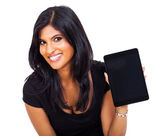 Indian businesswoman showing tablet computer — Stock Photo