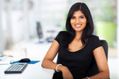 Lovely young businesswoman sitting in office — Stock Photo