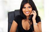 Smart businesswoman talking on telephone — Stock Photo