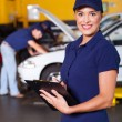 Стоковое фото: Beautiful female garage receptionist