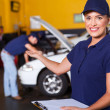 Friendly female vehicle service center worker welcome - Stock Photo