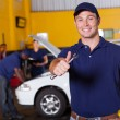Happy male mechanic giving thumb up — Stock Photo