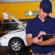 Foto Stock: Male auto workshop manager