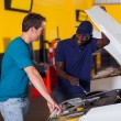 African auto mechanic and customer — Stock Photo #24226845