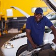 African car mechanic - Stock Photo