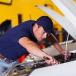 Auto mechanic repairing vehicle — Stock Photo #24227095