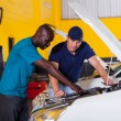 Africmshowing auto mechanic car problem — Stock Photo #24227293