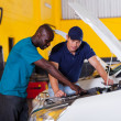 Stock Photo: African man showing auto mechanic car problem