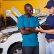 African man inside vehicle workshop — Stock Photo
