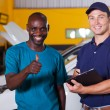 Customer giving thumb up in car repair shop — Stock Photo