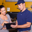 Foto Stock: Mechanic and customer