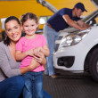 Mother and daughter in garage - Stock Photo