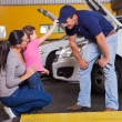 Cute little girl palying with auto mechanic — Stock Photo #24227963