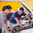 Stock Photo: Mechanic showing customer car problem