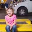 Daughter waiting for mother in garage — Stock Photo