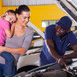 Young mother taking her car for repair — Stock Photo