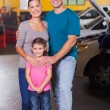 Happy family in car service center — Stock Photo