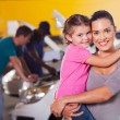 Young mother and daughter waiting in garage — Stock Photo #24229039