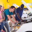 Young family taking their car for repair — Stock Photo