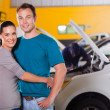 Couple waiting inside garage — Stock Photo #24229487