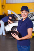 Beautiful female garage receptionist — Stock Photo