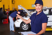 Friendly female vehicle service center worker welcome — Stock Photo
