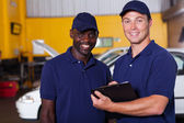 Vehicle service center manager and worker — Stock Photo