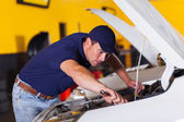 Auto mechanic repairing vehicle — Stock Photo