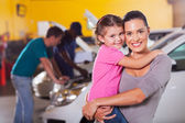 Young mother and daughter waiting in garage — Stock Photo
