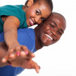 Young african woman enjoying piggyback ride on boyfriends back — Stock Photo #24411235