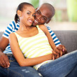 Royalty-Free Stock Photo: Loving african american couple sitting on the couch
