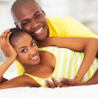 Loving african american couple lying in bed — Stock Photo