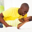 Young african couple lying on bed — Stock Photo