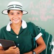 Cheerful teen school girl holding tablet computer — Stock fotografie