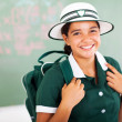 Beautiful teenage schoolgirl carrying backpack — Stock Photo