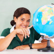 Teenage school girl pointing the globe — Stock Photo