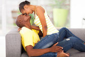 Beautiful young african woman flirting with boyfriend — Stock Photo