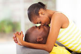 Young african american couple kissing — Stock Photo