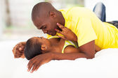 Young african couple in bed — Stock Photo