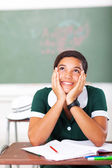 Teenage girl daydreaming in classroom — Stock Photo