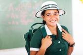 Beautiful teenage schoolgirl carrying backpack — Stock Photo
