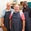 Stock Photo: Senior small business owner and employees