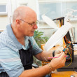 Senior electrician examining a ciruit board — Stock Photo